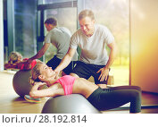 Купить «smiling young woman with personal trainer in gym», фото № 28192814, снято 29 июня 2014 г. (c) Syda Productions / Фотобанк Лори