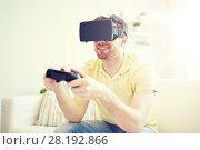Купить «man in virtual reality headset with controller», фото № 28192866, снято 12 марта 2016 г. (c) Syda Productions / Фотобанк Лори