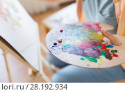 Купить «artist with paint palette painting at art studio», фото № 28192934, снято 1 июня 2017 г. (c) Syda Productions / Фотобанк Лори