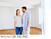 Купить «happy couple hugging at new home», фото № 28192942, снято 4 июня 2017 г. (c) Syda Productions / Фотобанк Лори