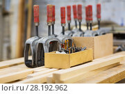 Купить «drills and woodworking tools at workshop», фото № 28192962, снято 10 ноября 2017 г. (c) Syda Productions / Фотобанк Лори