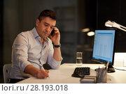 Купить «businessman calling on sartphone at night office», фото № 28193018, снято 6 декабря 2017 г. (c) Syda Productions / Фотобанк Лори