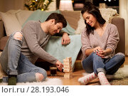Купить «happy couple playing block-stacking game at home», фото № 28193046, снято 13 января 2018 г. (c) Syda Productions / Фотобанк Лори