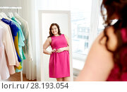 Купить «happy plus size woman in dress looking at mirror», фото № 28193054, снято 21 февраля 2016 г. (c) Syda Productions / Фотобанк Лори