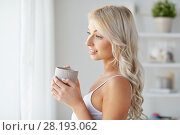 Купить «woman in underwear drinking coffee at home window», фото № 28193062, снято 20 апреля 2017 г. (c) Syda Productions / Фотобанк Лори
