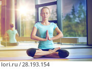 Купить «happy woman meditating in lotus pose on mat», фото № 28193154, снято 29 июня 2014 г. (c) Syda Productions / Фотобанк Лори