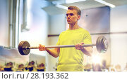 Купить «man doing exercise with barbell in gym», фото № 28193362, снято 29 июня 2014 г. (c) Syda Productions / Фотобанк Лори