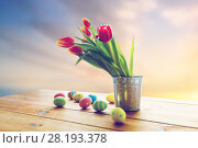 Купить «easter eggs and flowers in bucket», фото № 28193378, снято 28 января 2016 г. (c) Syda Productions / Фотобанк Лори