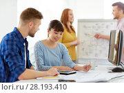 Купить «creative team with blueprint at office», фото № 28193410, снято 27 февраля 2016 г. (c) Syda Productions / Фотобанк Лори