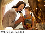 Купить «happy family with smartphone in kids tent at home», фото № 28193586, снято 27 января 2018 г. (c) Syda Productions / Фотобанк Лори