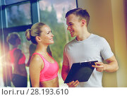 Купить «smiling young woman with personal trainer in gym», фото № 28193610, снято 29 июня 2014 г. (c) Syda Productions / Фотобанк Лори