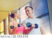 Купить «smiling young woman with personal trainer in gym», фото № 28193618, снято 29 июня 2014 г. (c) Syda Productions / Фотобанк Лори