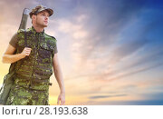 Купить «young soldier or hunter with gun over sky», фото № 28193638, снято 14 августа 2014 г. (c) Syda Productions / Фотобанк Лори