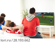Купить «football fans watching soccer game on tv at home», фото № 28193662, снято 14 августа 2016 г. (c) Syda Productions / Фотобанк Лори
