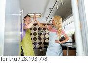 Купить «couple of sellers making high five at food truck», фото № 28193778, снято 1 августа 2017 г. (c) Syda Productions / Фотобанк Лори