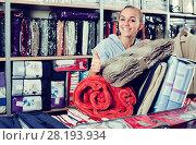 Купить «Woman client buying multiple items in textile store», фото № 28193934, снято 24 сентября 2018 г. (c) Яков Филимонов / Фотобанк Лори