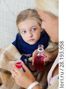 Купить «Stressed woman giving liquid medicine to little girl with grippe», фото № 28193958, снято 23 марта 2019 г. (c) Яков Филимонов / Фотобанк Лори