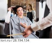 Купить «Upset woman in hairdress salon», фото № 28194134, снято 7 марта 2017 г. (c) Яков Филимонов / Фотобанк Лори