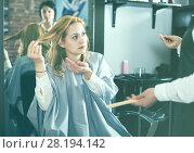 Купить «Unhappy woman in hairdress salon», фото № 28194142, снято 7 марта 2017 г. (c) Яков Филимонов / Фотобанк Лори