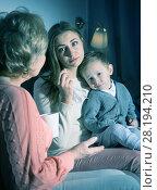 Купить «Two adult female are talking about emotional film in evening», фото № 28194210, снято 15 февраля 2018 г. (c) Яков Филимонов / Фотобанк Лори