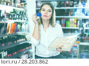 Купить «Woman choosing face powder at shopwoman, girl, customer, cosmetic, shop, store, boutique, test, applying, powder, foundation, brush, decorative, makeup, face, beauty, accessories, femininity, stylish, visage, choosing, shopping, market, sale, offer, choice, assortment, sample, shelves, new, quality, brand, price, emotion, concentrated, positive, indoors, portrait, young, adult, female, person, one, 20s, spanish, hobby, leisure, lifestyle,», фото № 28203862, снято 31 января 2018 г. (c) Яков Филимонов / Фотобанк Лори