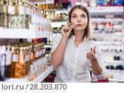 Купить «Stylish girl shopping in cosmetics store, choosing perfume», фото № 28203870, снято 31 января 2018 г. (c) Яков Филимонов / Фотобанк Лори