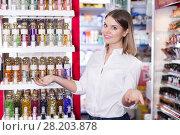 Купить «Saleswoman helping to choose perfume in beauty store», фото № 28203878, снято 31 января 2018 г. (c) Яков Филимонов / Фотобанк Лори