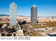 Купить «Skyscrapers on seafront of Barcelona», фото № 28203882, снято 24 декабря 2017 г. (c) Яков Филимонов / Фотобанк Лори