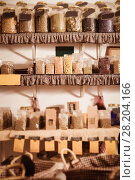 Купить «Glass cans with many dried spices plants is standing on shelf», фото № 28204166, снято 13 июня 2017 г. (c) Яков Филимонов / Фотобанк Лори