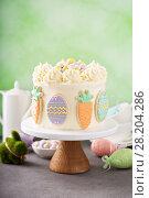 Купить «Carrot cake with frosting for Easter», фото № 28204286, снято 8 марта 2018 г. (c) Елена Веселова / Фотобанк Лори