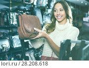Купить «Satisfied woman holding new hand bag», фото № 28208618, снято 17 июня 2019 г. (c) Яков Филимонов / Фотобанк Лори