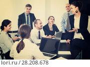 Купить «Team discussing business project during coffee break», фото № 28208678, снято 28 октября 2016 г. (c) Яков Филимонов / Фотобанк Лори