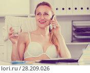 Купить «Female working in bra», фото № 28209026, снято 24 апреля 2017 г. (c) Яков Филимонов / Фотобанк Лори