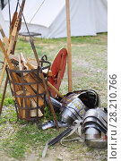 Купить «MOSCOW - JUN 06, 2015: Equipment shield Roman soldier on the grass near the forged baskets of firewood at the festival Times and epoch: Ancient Rome in Kolomenskoye», фото № 28210766, снято 6 июня 2015 г. (c) Losevsky Pavel / Фотобанк Лори