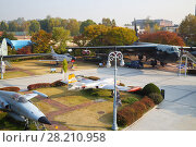 Купить «SEOUL - NOV 4, 2015: Freight big airplane near small and trees in military museum. South Korea started aerodynamic testing of next-generation fighter», фото № 28210958, снято 4 ноября 2015 г. (c) Losevsky Pavel / Фотобанк Лори