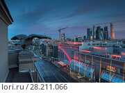 Купить «Sculpture of eagle and view of Moscow City business complex in evening in Moscow. I have only one version of the photo with sharpening», фото № 28211066, снято 15 мая 2014 г. (c) Losevsky Pavel / Фотобанк Лори