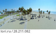 Купить «LOS ANGELES - OCT 19, 2014: Venice Beach at autumn sunny day. Aerial view», фото № 28211082, снято 19 октября 2014 г. (c) Losevsky Pavel / Фотобанк Лори
