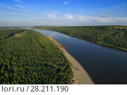 Купить «Above view of beautiful landscape of river flowing in middle of forest at summer», фото № 28211190, снято 26 августа 2015 г. (c) Losevsky Pavel / Фотобанк Лори
