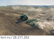 Купить «Tractor work on field at spring sunny day. Aerial view», фото № 28211202, снято 19 августа 2015 г. (c) Losevsky Pavel / Фотобанк Лори