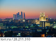 Купить «Panorama of roofs, illuminated buildings and skyscrapers during sunset in Moscow», фото № 28211310, снято 13 октября 2015 г. (c) Losevsky Pavel / Фотобанк Лори