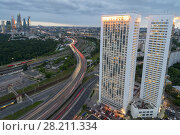 MOSCOW, RUSSIA - JUL 8, 2016: Building on Begovaya street, highway, twin 38-storey towers - is part of largest residential complex with 1946 apartments in Moscow. Редакционное фото, фотограф Losevsky Pavel / Фотобанк Лори