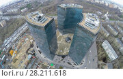 Купить «MOSCOW - APR 21, 2015: Urban sector with business complex Lotos at spring cloudy day. Aerial view video frame», фото № 28211618, снято 21 апреля 2015 г. (c) Losevsky Pavel / Фотобанк Лори