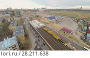 Купить «MOSCOW - APR 24, 2015: Road traffic near construction site of interchange not far from Spartak stadium at spring cloudy day. Aerial view», фото № 28211638, снято 24 апреля 2015 г. (c) Losevsky Pavel / Фотобанк Лори