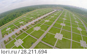 Купить «Large territory of Federal Memorial Cemetery at spring cloudy day. Aerial view video frame», фото № 28211694, снято 19 июня 2018 г. (c) Losevsky Pavel / Фотобанк Лори