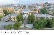 Купить «MOSCOW - JUN 22, 2015: Cityscape with edifice of Chemical-Technologycal University named by D.I. Mendeleev at summer day. Aerial view videoframe», фото № 28211726, снято 22 июня 2015 г. (c) Losevsky Pavel / Фотобанк Лори