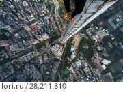 Купить «Skyscrapers, office buildings roofs, roofer legs in Hong Kong city, China, aerial view», фото № 28211810, снято 16 августа 2015 г. (c) Losevsky Pavel / Фотобанк Лори