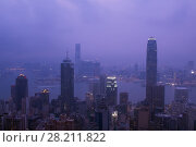 Купить «Night view of city in fog and Victoria Harbour in Hong Kong, China, view from Queen Garden», фото № 28211822, снято 4 сентября 2015 г. (c) Losevsky Pavel / Фотобанк Лори