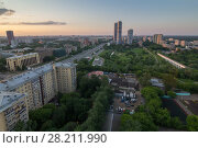 Купить «Road, green park and skyscrapers in Moscow, Russia at summer evening», фото № 28211990, снято 29 мая 2016 г. (c) Losevsky Pavel / Фотобанк Лори
