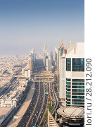 Купить «Sheikh Zaid Highway and many skyscrapers at sunny day, Dubai, United Arab Emirates», фото № 28212090, снято 9 января 2017 г. (c) Losevsky Pavel / Фотобанк Лори