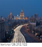 Купить «MOSCOW - APR 12, 2016: Kutuzovsky Prospect at evening. Kutuzovsky Avenue was constructed in 1957-1963, length - 8.3 km», фото № 28212122, снято 12 апреля 2016 г. (c) Losevsky Pavel / Фотобанк Лори